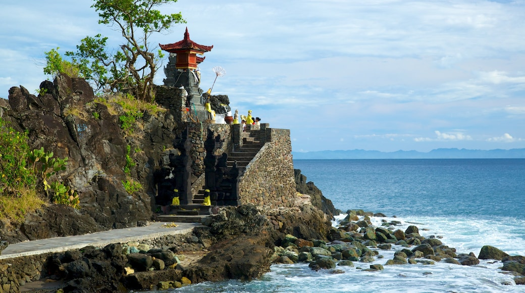 Lombok showing religious aspects, a temple or place of worship and rocky coastline
