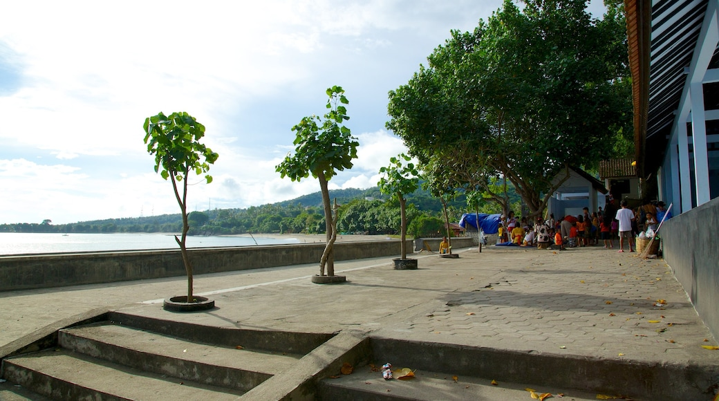 Lombok featuring a temple or place of worship and general coastal views