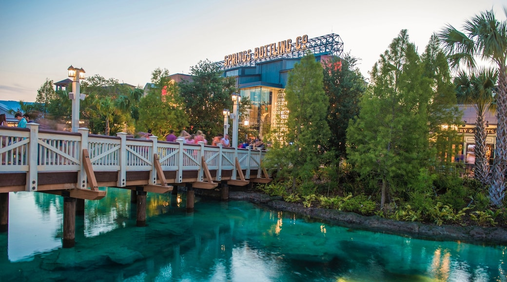 Disney Springs® showing a river or creek, a bridge and a sunset