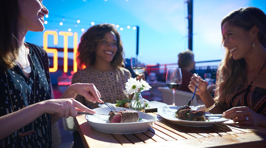 Disney Springs® which includes night scenes, dining out and food