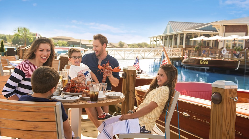 Disney Springs® featuring food and dining out as well as a family