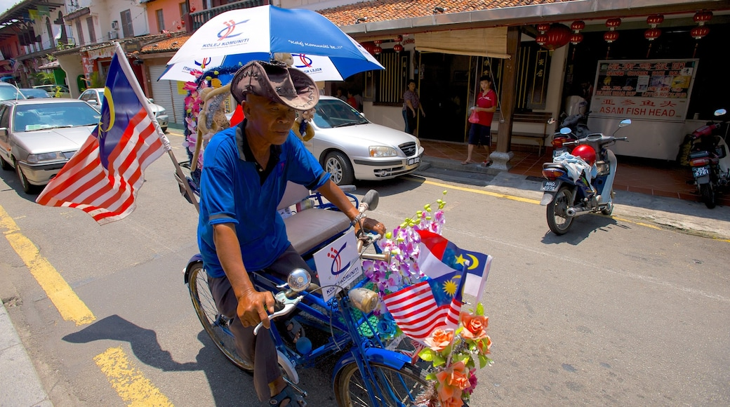 Melaka Historical City which includes cycling and street scenes as well as an individual male