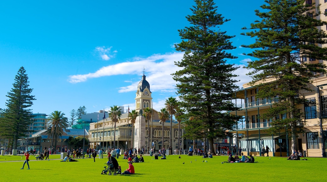 Glenelg Beach showing a city and a park as well as a large group of people