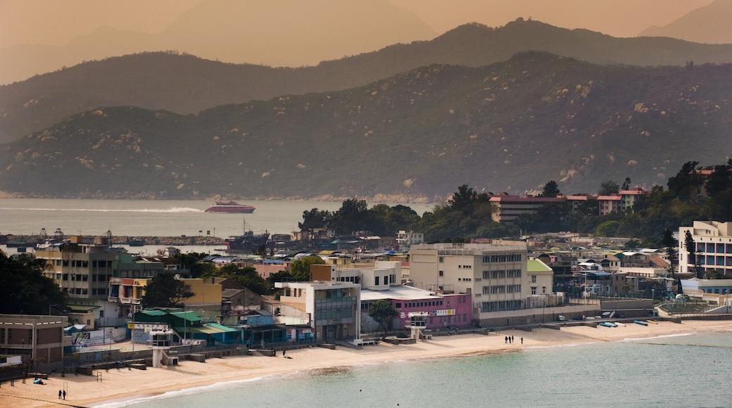 Cheung Chau featuring a beach, a coastal town and a sunset