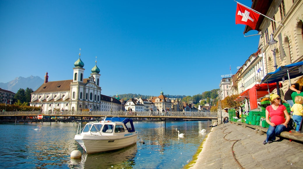 Old Town Lucerne which includes religious elements, a river or creek and a bridge