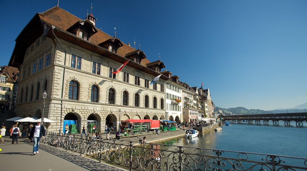 Old Town Lucerne featuring a river or creek, a bridge and a coastal town