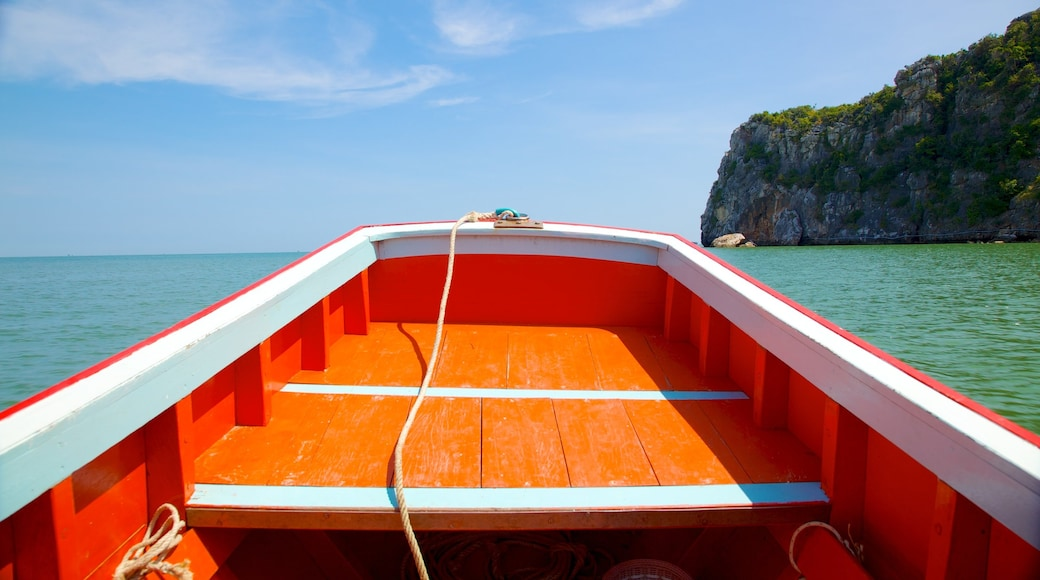 Hua Hin showing boating and rugged coastline