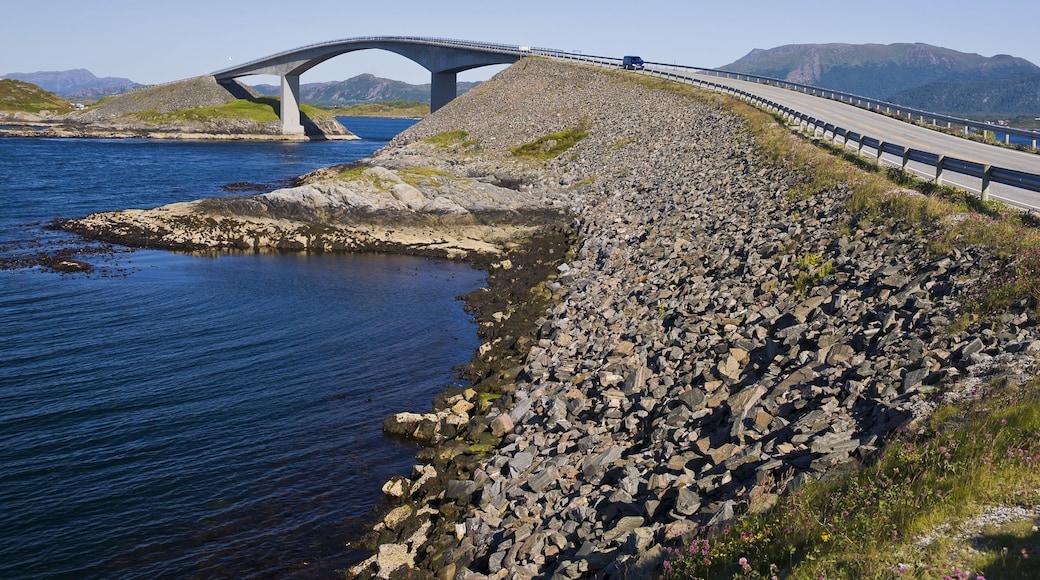 Trondheim which includes rugged coastline, a bridge and modern architecture