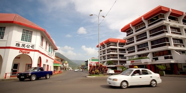 Apia which includes a city, signage and street scenes