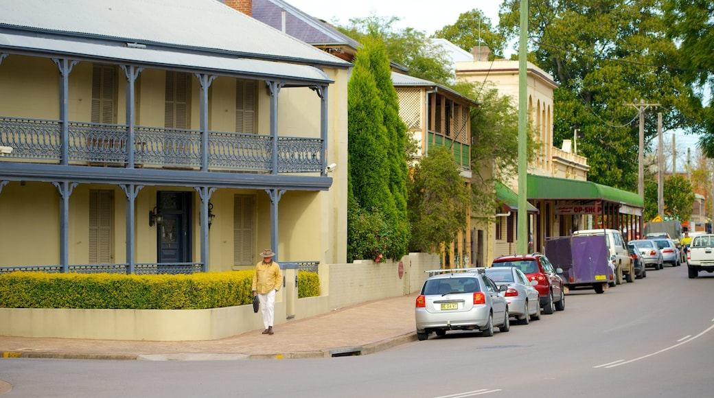 Singleton showing a small town or village and street scenes as well as an individual male