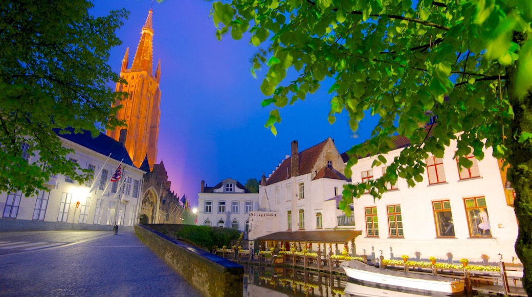 Bruges which includes street scenes, heritage architecture and a river or creek