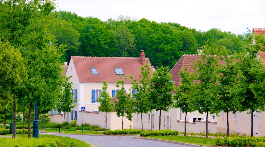 Magny-le-Hongre das einen Straßenszenen, Haus und Kleinstadt oder Dorf