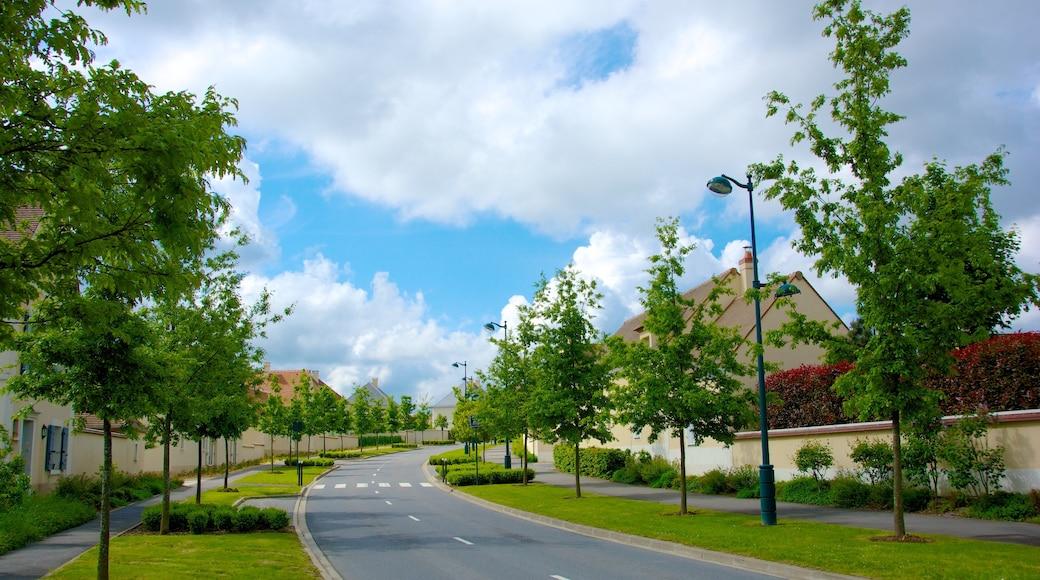 Magny-le-Hongre welches beinhaltet Kleinstadt oder Dorf, Straßenszenen und Haus
