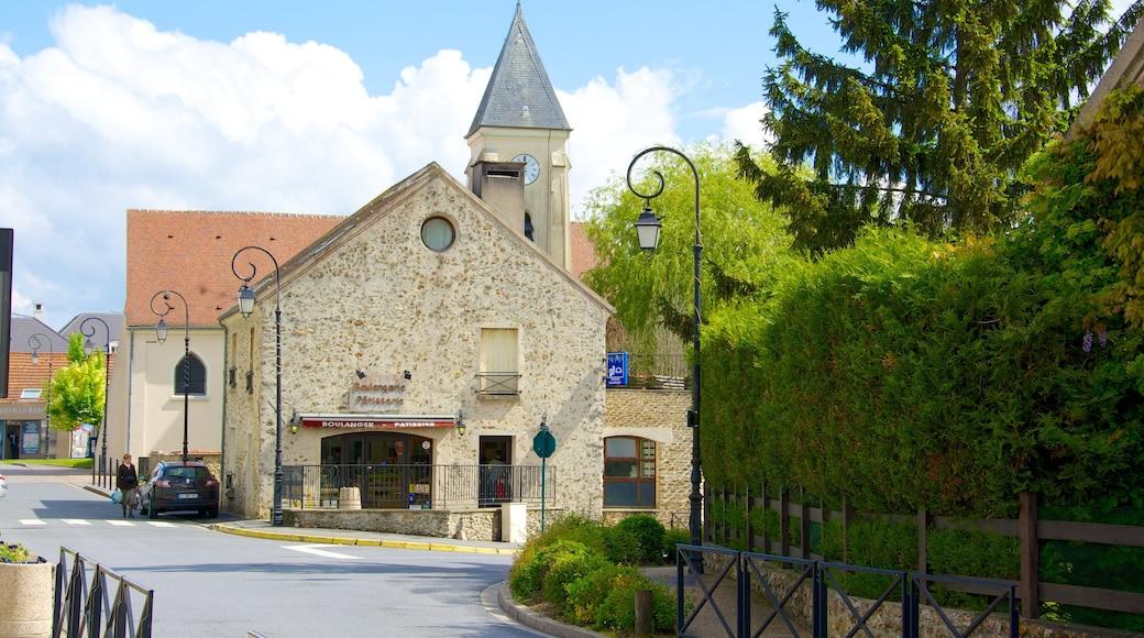 Magny-le-Hongre welches beinhaltet Kleinstadt oder Dorf, Straßenszenen und historische Architektur