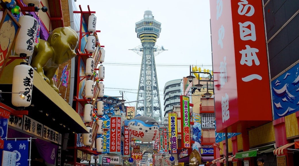 Tsutenkaku Tower featuring street scenes, a skyscraper and a city