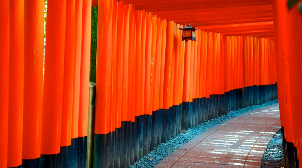 Fushimi Inari Shrine featuring interior views and a temple or place of worship