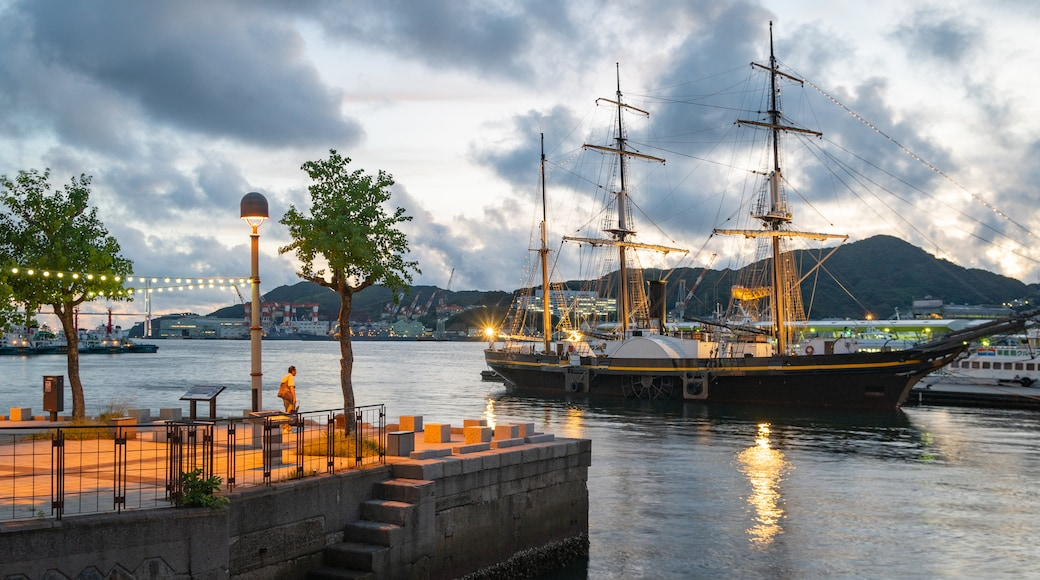 Nagasaki featuring a sunset, a bay or harbor and heritage elements