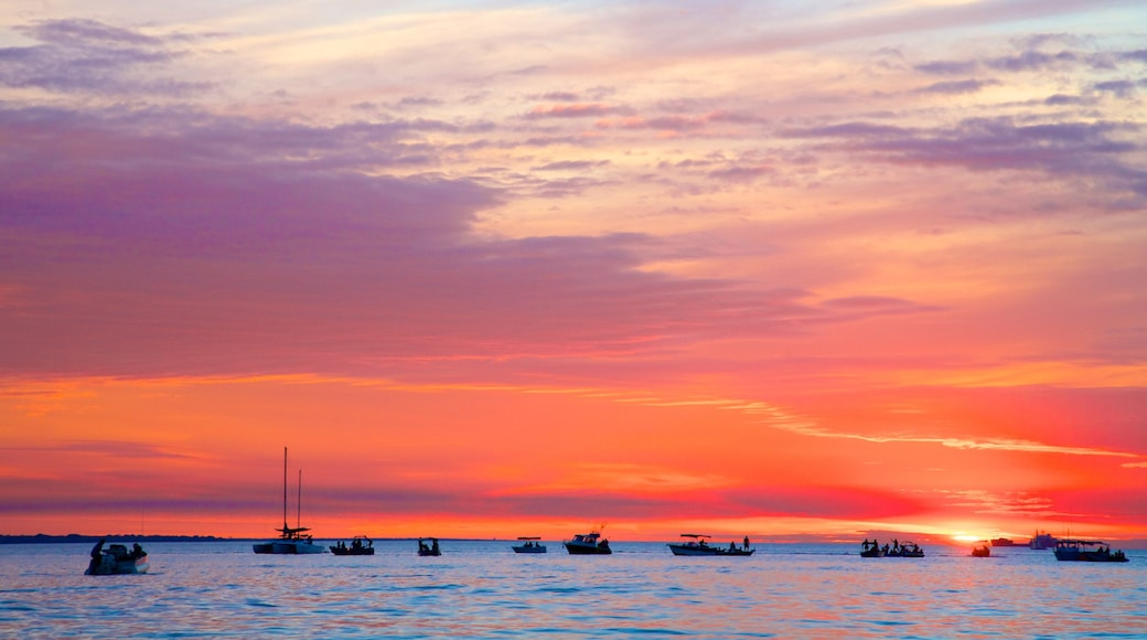 Darwin featuring general coastal views, a sunset and boating
