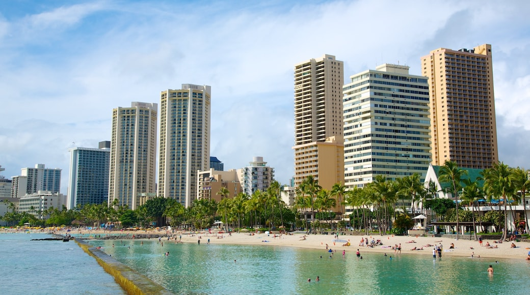 Honolulu which includes tropical scenes, a coastal town and swimming