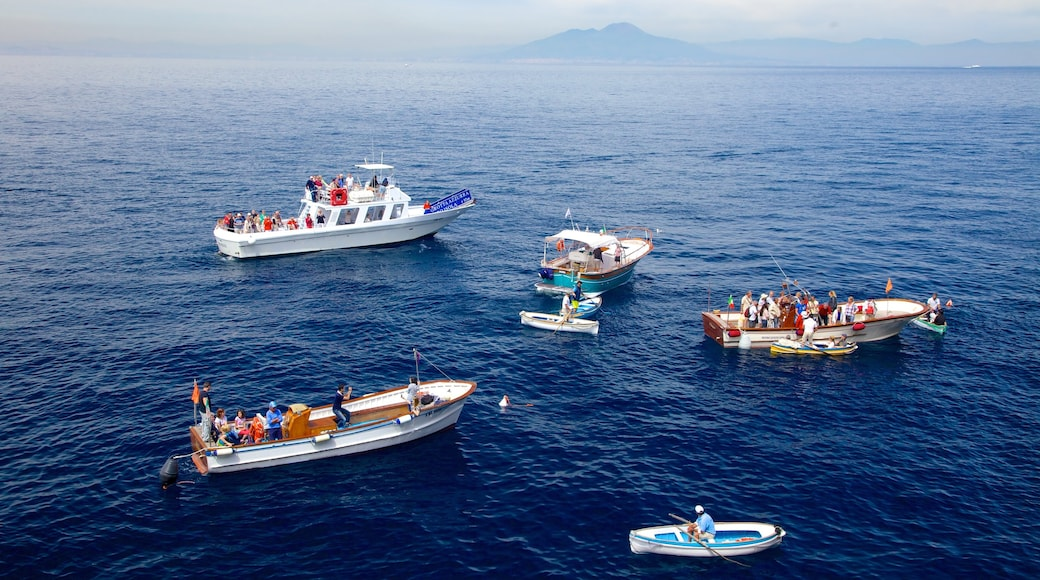 Blue Grotto which includes general coastal views and boating as well as a large group of people