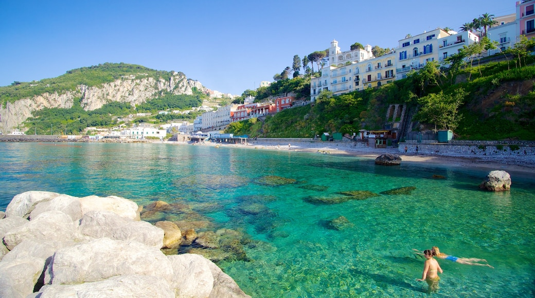 Capri which includes rocky coastline, swimming and a coastal town