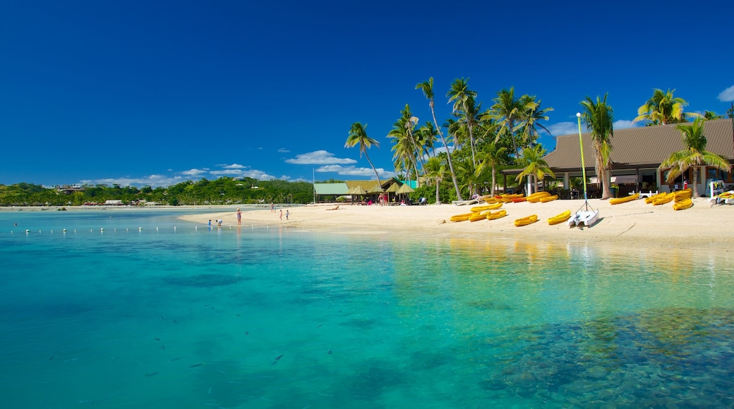Fiji which includes a sandy beach, a luxury hotel or resort and a coastal town