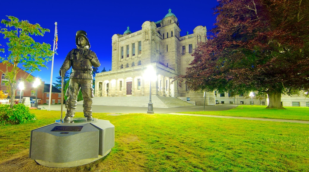 British Columbia Parliament Building featuring night scenes, an administrative building and a statue or sculpture