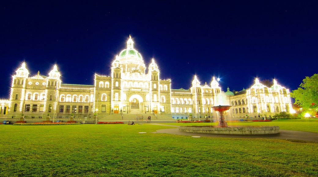 British Columbia Parliament Building showing night scenes, heritage architecture and an administrative building