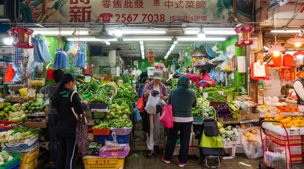 Shek O featuring food and markets as well as a small group of people