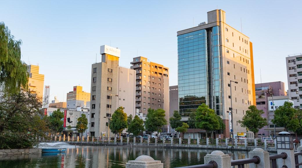 Matsuyama featuring a city, a sunset and a pond