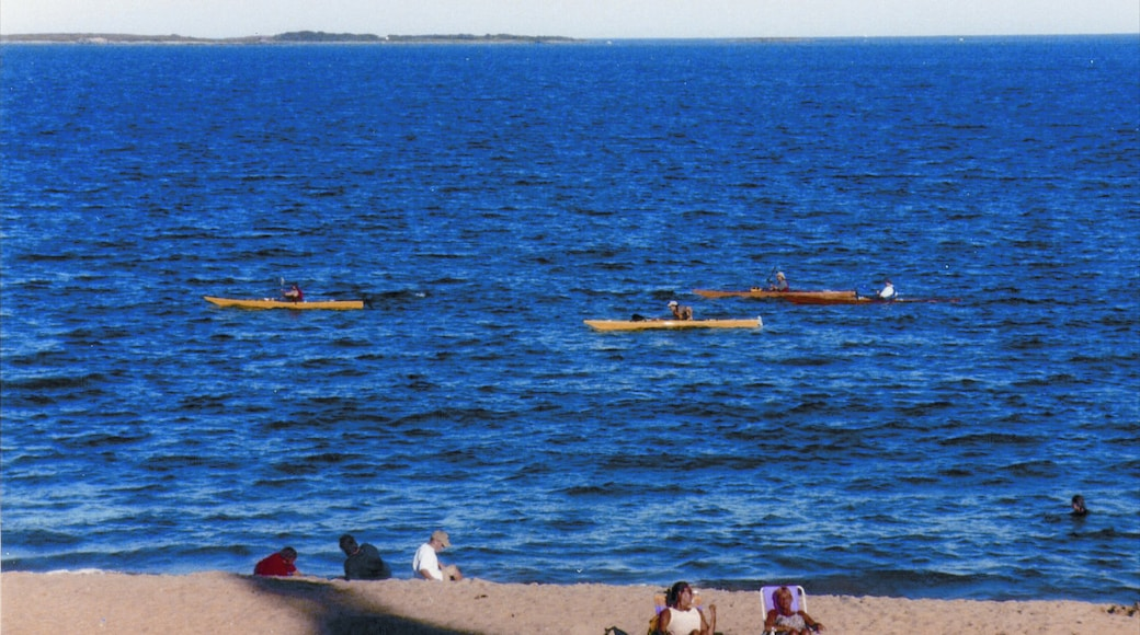 Old Orchard Beach featuring a beach and kayaking or canoeing as well as a small group of people