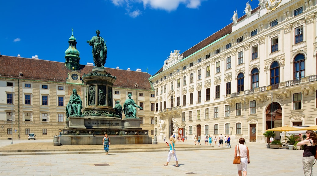 Hofburg Imperial Palace which includes heritage architecture, château or palace and a statue or sculpture