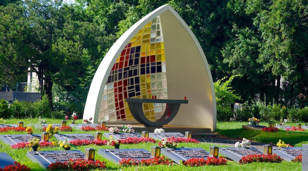 Wiener Zentralfriedhof bevat een monument, bloemen en een park