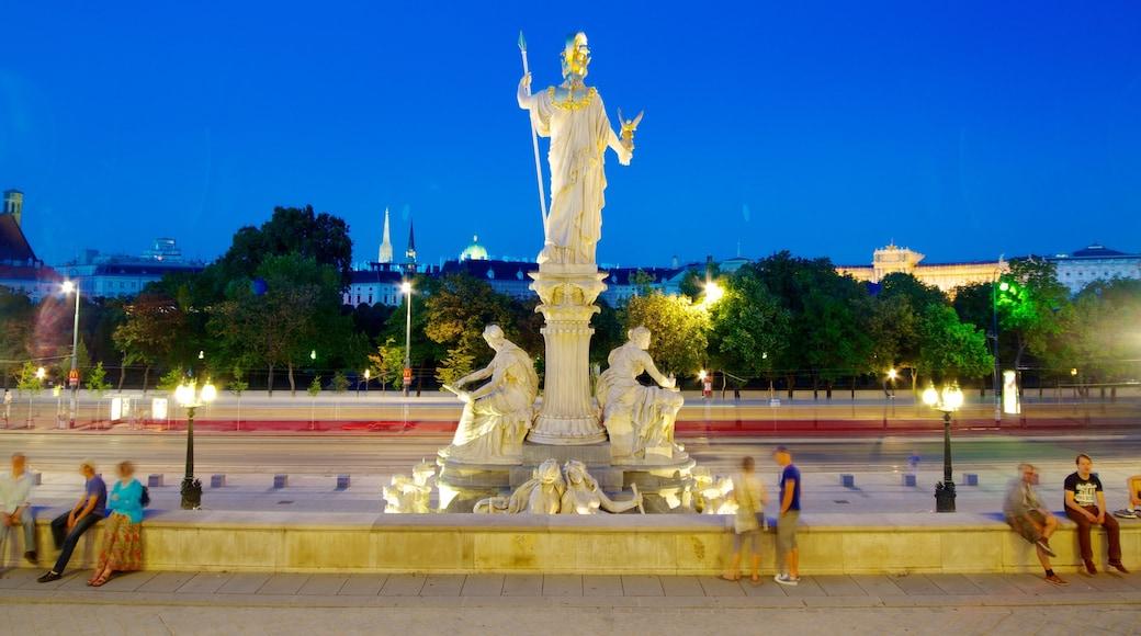 Parlamentsgebäude das einen bei Nacht, Statue oder Skulptur und Stadt