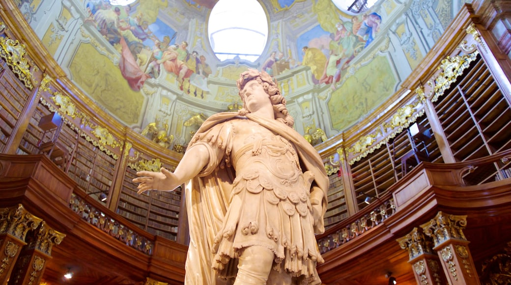 Austrian National Library showing a statue or sculpture, a monument and interior views