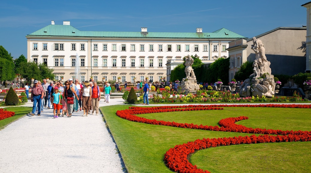 Mirabell Palace and Gardens featuring heritage architecture, flowers and a city