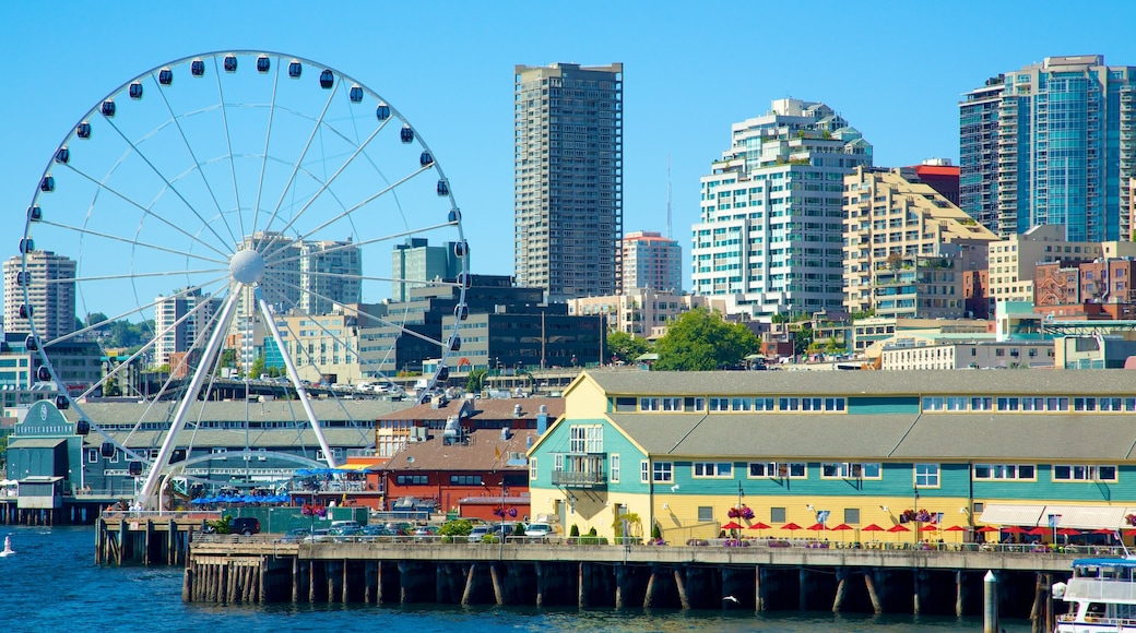 Seattle Great Wheel showing a bay or harbor, a skyscraper and modern architecture