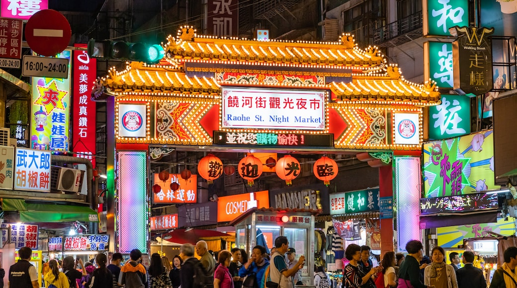 Raohe Street Night Market featuring signage, heritage elements and street scenes