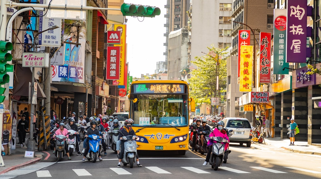 Beitou showing a city, street scenes and motorbike riding