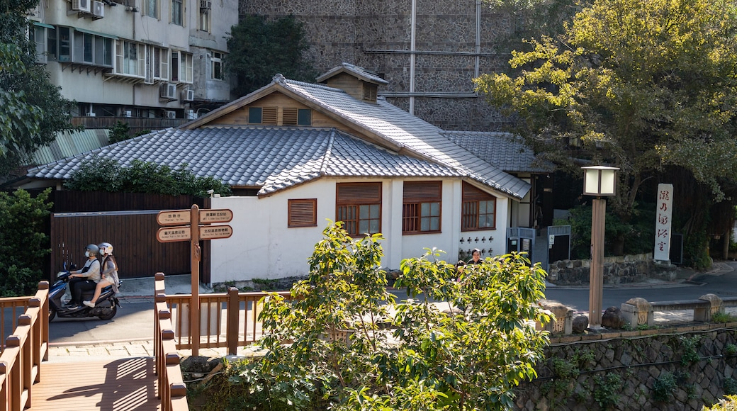 Beitou showing motorbike riding as well as a couple