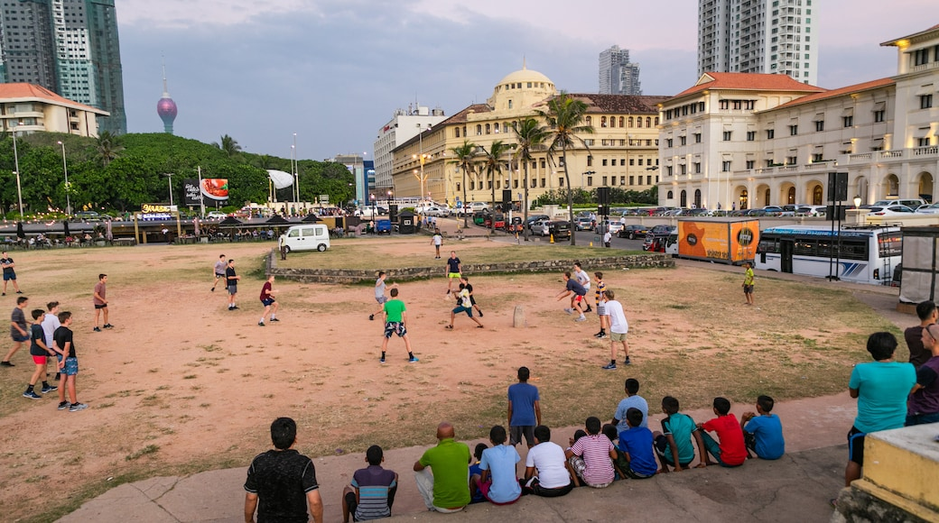 Colombo which includes a coastal town and a sporting event as well as a large group of people