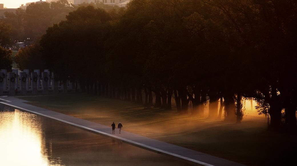 Washington showing a sunset, a lake or waterhole and a garden