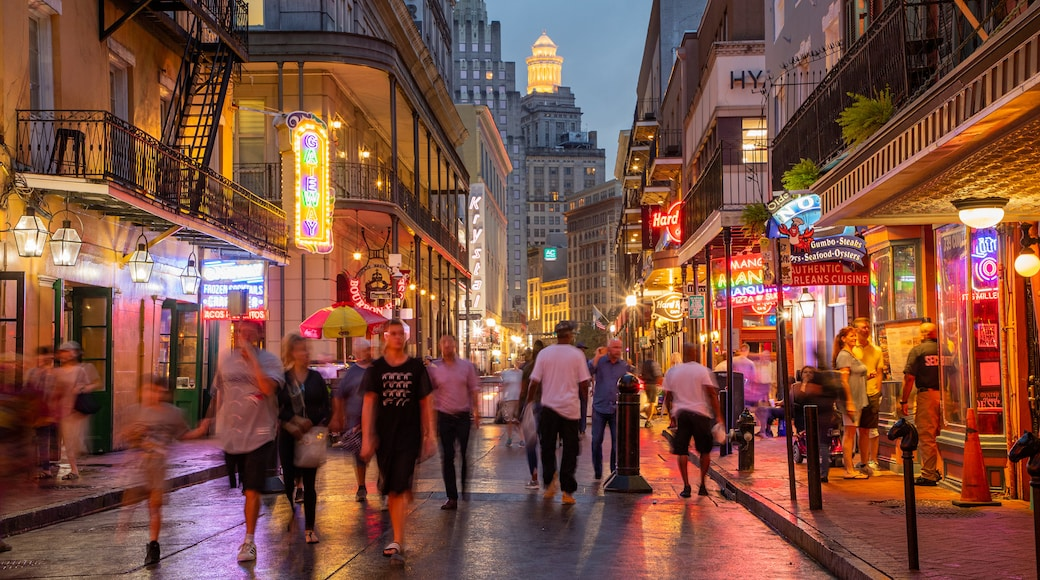 Bourbon Street featuring nightlife, street scenes and a city