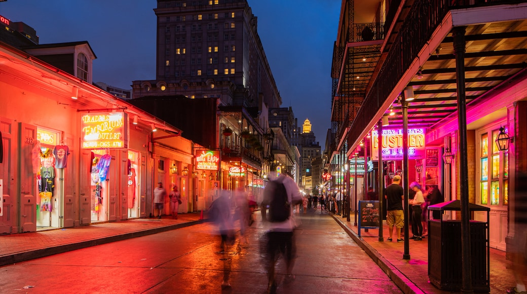Bourbon Street which includes night scenes, a city and street scenes