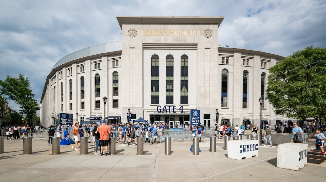 Yankee Stadium featuring signage and street scenes