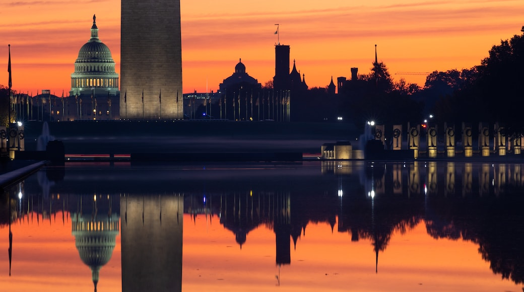 National Mall which includes a sunset and a lake or waterhole