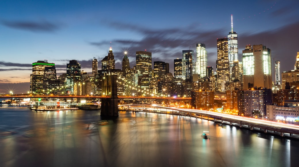 Manhattan Bridge showing night scenes, a city and a bridge