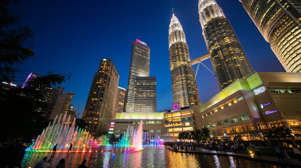 KLCC Park featuring a high rise building, night scenes and a fountain
