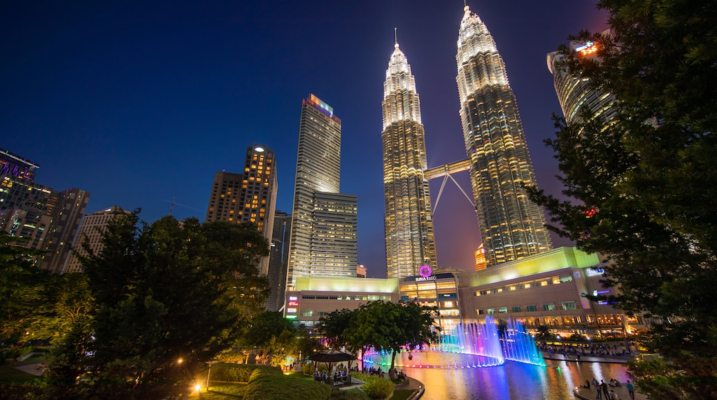 KLCC Park featuring a high rise building, a city and night scenes