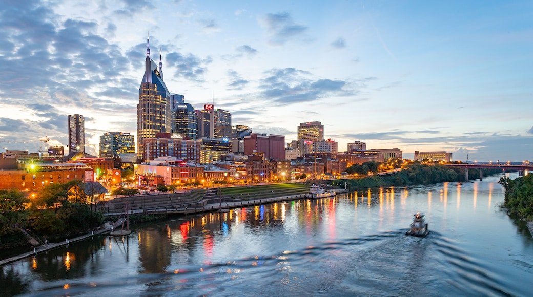 Downtown Nashville which includes a city, a sunset and boating
